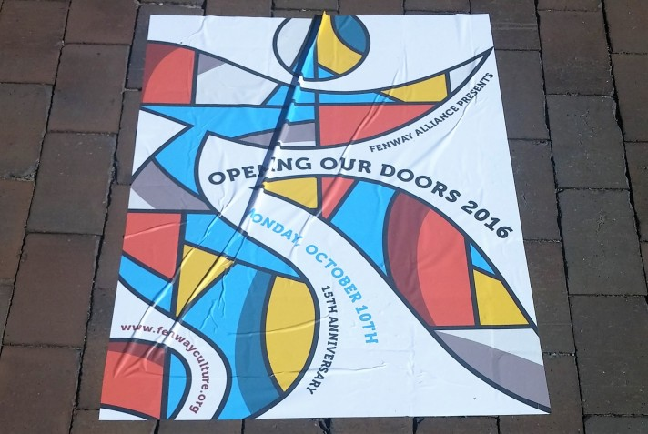 A poster for the event is displayed on the ground in the Christian Science Plaza
